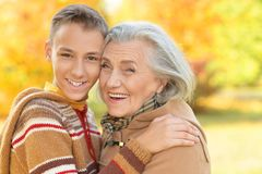 Portrait of happy grandmother and grandson posing royalty free stock photos