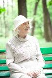 Portrait of  happy grandmother on a park bench, Royalty Free Stock Photography