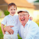 Portrait of happy grandpa and grandson, outdoors Royalty Free Stock Photography