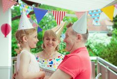 Portrait of happy grandparents celebrating birthday with their p Stock Photos