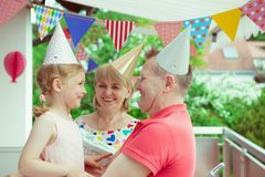 Portrait of happy grandparents celebrating birthday with their p Stock Images