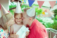 Portrait of happy grandparents celebrating birthday with their p Royalty Free Stock Photo