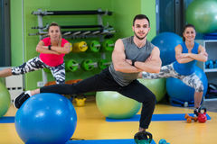Portrait of happy group exercising on Swiss ball Royalty Free Stock Photos
