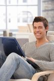 Portrait of happy guy with laptop computer Royalty Free Stock Photo