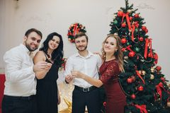 Happy guys and girls enjoying New Year party with Bengal lights. Portrait of happy guys and girls enjoying New Year party with Bengal lights stock image