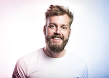 Portrait of a happy handsome full beard man. On the white background. Color toned image royalty free stock photo