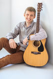 Portrait of happy handsome man with guitar Stock Image