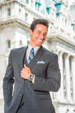 Portrait of Happy, Handsome,  Middle Age American Businessman in. Happy Businessman. Dressing in dark blue three piece suit, necktie, wearing wristwatch Stock Photo