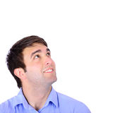 Portrait of happy handsome young man looking up isolated on whi Stock Image