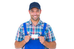 Portrait of happy handyman holding visiting card Stock Photo