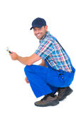 Portrait of happy handyman holding wrench Royalty Free Stock Images