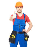 Handyman with tools showing thumbs up sign Stock Image