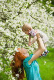 Portrait of happy happy mother and son in spring garden Royalty Free Stock Photos