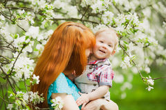 Portrait of happy happy mother and son in spring garden royalty free stock image