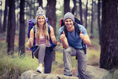 Portrait of a happy hiker couple with thumbs up Royalty Free Stock Photos