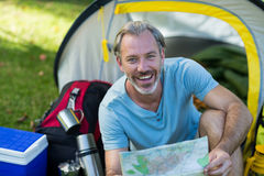 Portrait of happy hiker holding map Royalty Free Stock Photos