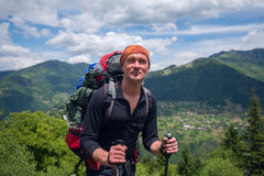 Portrait of happy hiker in the mountains Stock Photo