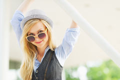 Portrait of happy hipster girl in the city Stock Photo