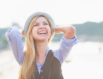 Portrait of happy hipster girl rejoicing in the city Royalty Free Stock Image