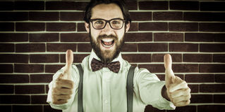Portrait of happy hipster with thumbs up gesture Stock Photo