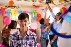 Portrait Of Happy Hispanic Child Smiling At Birthday Party. Group of happy children celebrating birthday at home, kids and friends having fun at party. Portrait stock photo
