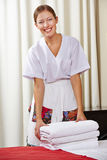 Portrait of a happy hotel maid Stock Image