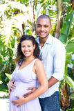 Portrait of happy husband touching pregnant wife belly Stock Images