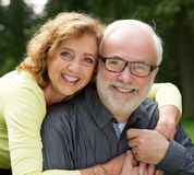 Portrait of a happy husband and wife smiling outdoors stock photo