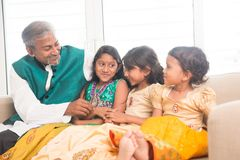 Happy father and daughters having fun. Portrait of happy Indian family bonding at home. Asian father and children indoors lifestyle Royalty Free Stock Image