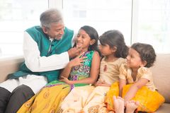 Happy Indian father and daughters. Portrait of happy Indian family having fun at home. Asian father and children indoors lifestyle Stock Photo