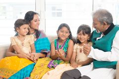 Happy Indian family indoors Royalty Free Stock Photo