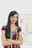 Portrait of happy Indian female tailor standing arms crossed Royalty Free Stock Image