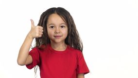Infant showing an idea then thumb up on white background. Slow motion. Portrait of happy infant in red T-shirt showing an idea then thumb up on white background stock video