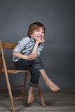Portrait of happy, joy boy on a gray background Stock Photo