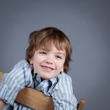 Portrait of happy, joy boy on a gray background Royalty Free Stock Photos