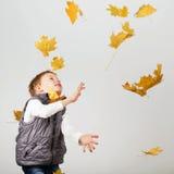 Portrait of happy joyful beautiful little boy against white back Stock Image