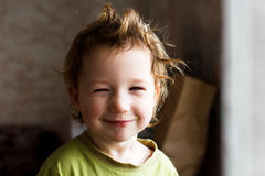 Portrait of happy joyful beautiful little boy with light hair, great hairstyle. He laughs and smiles Stock Images