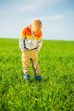 Portrait of happy joyful beautiful little boy outdoor at countryside. Pointing concept. Stock Image