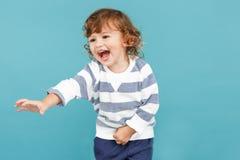 Portrait of happy joyful beautiful little boy, studio shot stock image