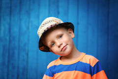 Portrait of happy joyful beautiful little boy wearing a straw ha Stock Photo