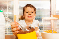 Portrait of happy kid boy with chocolate spread Stock Images
