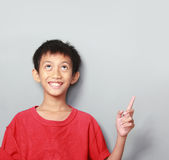 Portrait of happy kid pointing Stock Image
