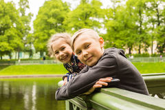Portrait of happy kids on a bright sunny day. Stock Photos