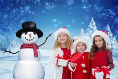 Portrait of happy kids holding christmas gifts Stock Photography