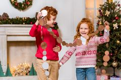 Happy kids with festive garland Royalty Free Stock Photo