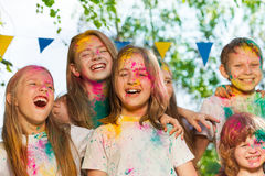 Portrait of happy kids smeared with colored powder Royalty Free Stock Images