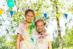 Portrait of happy kids smeared with colored powder Stock Photo