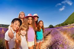 Portrait of happy kids standing in lavender field Stock Photography