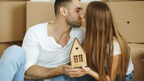 Portrait of happy kissing couple in new home Stock Images