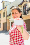 Portrait of a happy lady with a key of new house Stock Images